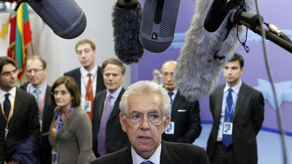 Mario Monti faces the media