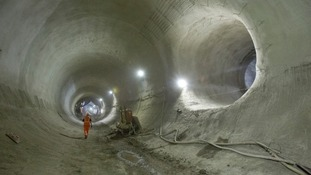 Dramatic photos reveal the massive scale of London's Crossrail tunnels as train network nears completion