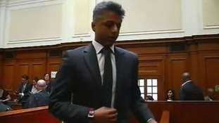 Shrien Dewani leaving the dock moments after the case against him was dismissed yesterday