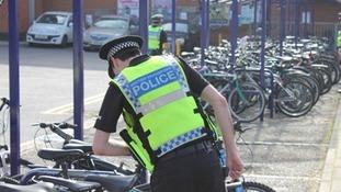police officer checking bike