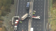 Aerial picture of recovery van at the scene of M25 collision between four lorries.