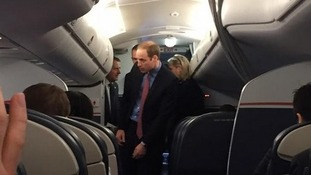 Passengers have brush with royalty after Prince William casually strolls onto a commercial flight