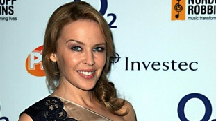 Kylie Minogue picks up a top Silver Clef award and looks forward to a 'surreal' reunion with Jason Donovan