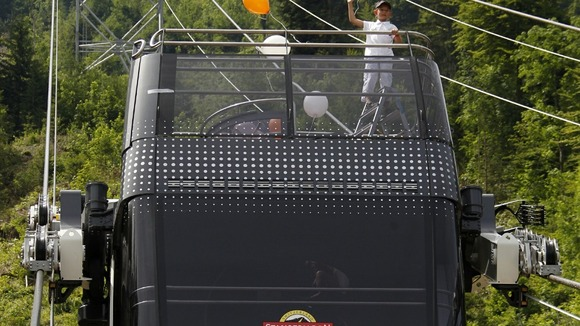 A young girl waves from the top deck of the Cabrio