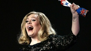 Adele collects her award for Album of the Year, during the 2012 Brit Awards