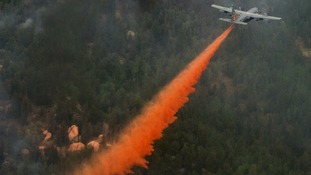 US Air Force C-130 Hercules aircraft spreading fire retardant