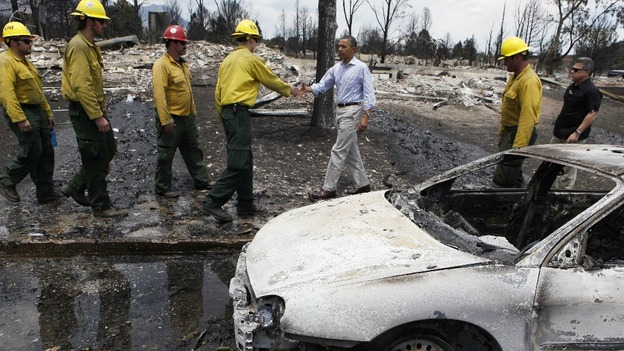 US President Barack Obama surveys fire damaged area with fire fighters in Colorado Springs