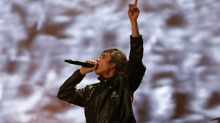 Ian Brown performs on stage on the opening night of their three night series of reunion concerts.