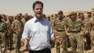 Nick Clegg speaks to soldiers at a training facility in Camp Bastion while on a visit to troops serving in Afghanistan.