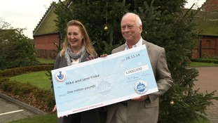 Jane and Mike Fiske with their £1 million cheque