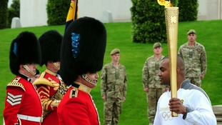 Lance Corporal Johnson Beharry VC carries the torch at the National Memorial Arboretum