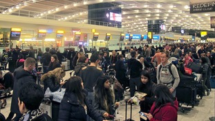 Passangers stand in line waiting to check in at Heathrow airport, London, UK, 12 December 2014.