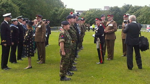 Lord Lieutenant Nigel Sherlock presents medals