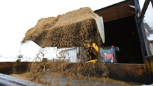 Sand is loaded onto gritting lorries for distribution on local roads.