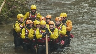Members of Tweed Valley Mountain Rescue training in River