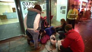 Charity workers provide food to a rough sleeper in Manchester