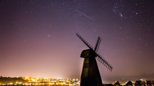 Sky-watchers brave icy conditions to capture dazzling Geminid meteor shower