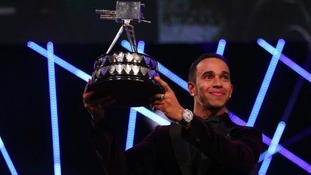 Lewis Hamilton lifts the BBC Sports Personality of the Year Award.