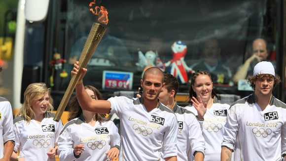 Max George of The Wanted carries the Olympic Flame