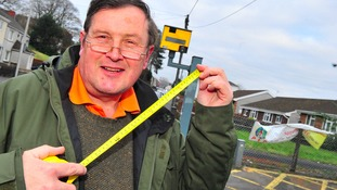 man with tape measure