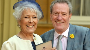 Michael and Lynda pictured together as she received her OBE in March this year.