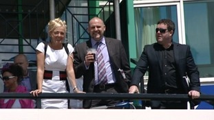 Racegoers enjoy the sunshine in the build up to the race.