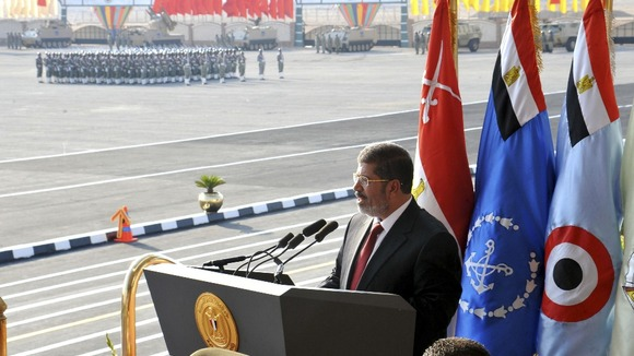 Egypt&#x27;s new President Mursi delivers a speech during a ceremony 