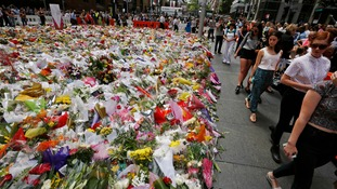 Floral tributes left near scene of siege
