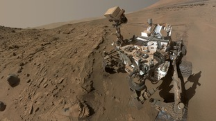 The Curiosity rover pictured on Mars in a 'selfie'.