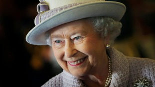 The queen smiling.