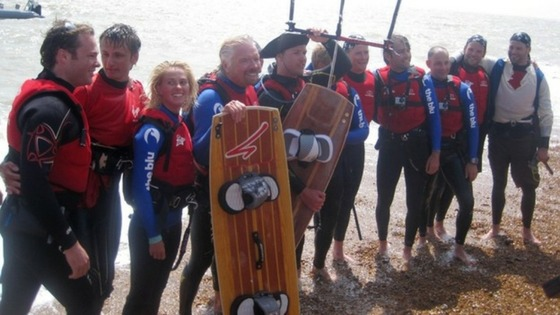 Sir Richard Branson (4th left) on Folkstone Beach after he had to abandon his attempt to kite-surfing across the Channel on Saturday