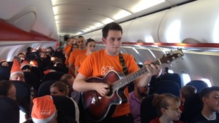 Choir sings at 39,000 feet in the air