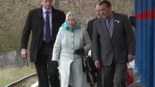 The Queen arrives on the 12.21 train into King's Lynn, Norfolk