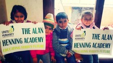 Syrian refugees smile as they start work at their new school - The Alan Henning Academy