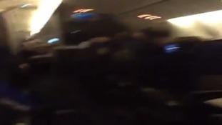 Shaky footage captured the passengers in varying states of distress in the cabin of the Boeing 777-200 jet.