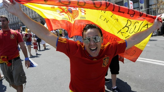A Spanish fan gets in the mood in Kiev ahead of Spain v Italy.