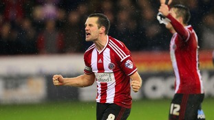 Michael Doyle celebrates after winning the Capital One Cup Quarter Final match at Bramall Lane