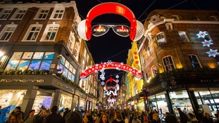 Shoppers looked for Christmas presents under the bright lights of Carnaby Street.
