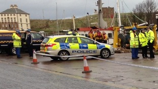 Teams from Police Scotland and HM Coastguard at Eyemouth Harbour