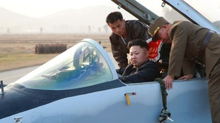 North Korean leader Kim Jong Un sits in a fighter jet.