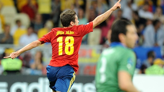 Spain's Ramos Jordi Alba (left) celebrates scoring their second goal of the game leaving Italy goalkeeper Gianluigi Buffon dejected.