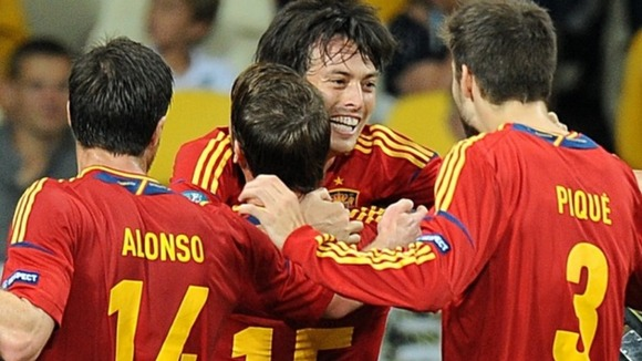 Spain's David Silva (centre) celebrates scoring their first goal of the game with team-mates.