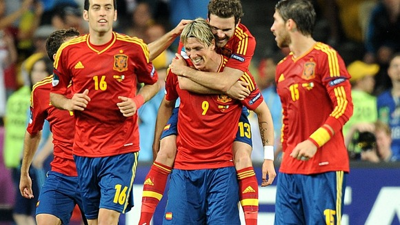 Spain's Juan Mata (centre right) celebrates scoring their fourth goal of the game with team-mate Fernando Torres (centre).