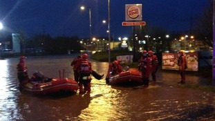 Asda staff and customers rescued after becoming stranded in store.