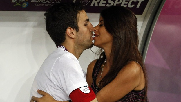 Spain midfielder Cesc Fabregas kisses girlfriend Daniella Semaan.