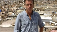 John Irvine amid the rubble of Banda Aceh after the 2004 tsunami.