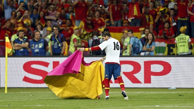 Spain defender Sergio Ramos pretends to be a matador.