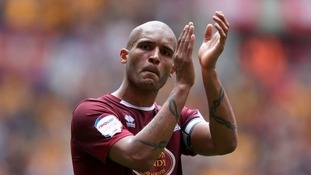 Clarke Carlisle retired from football while with Northampton Town in 2013