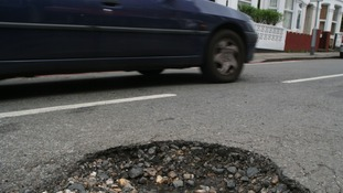 A pothole in a road in Tooting