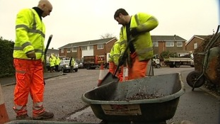 Workmen tackling potholes